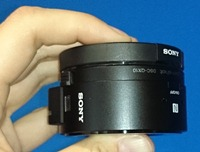 Sony QX10 in hand 200x152